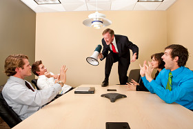 Boss standing on the conference table and yelling