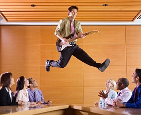 Businessman Playing Guitar in Meeting