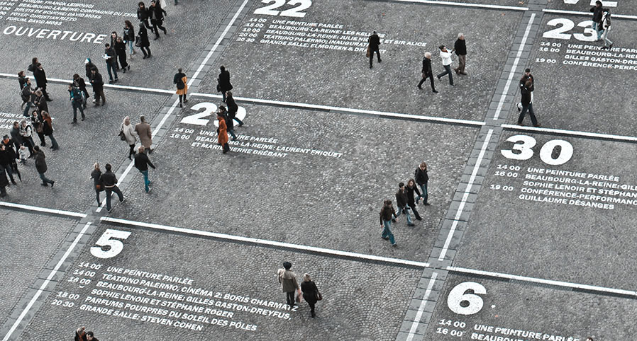 People walking on pavement marked by numbers
