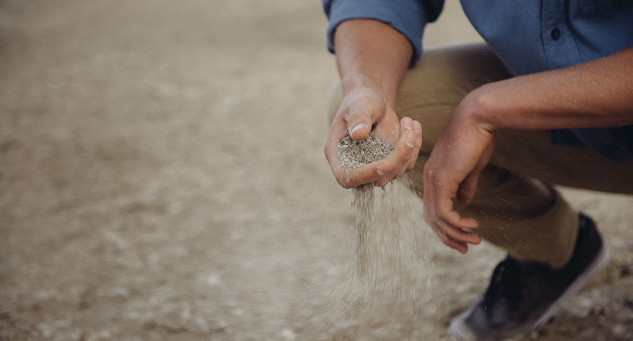 Man sifting grain