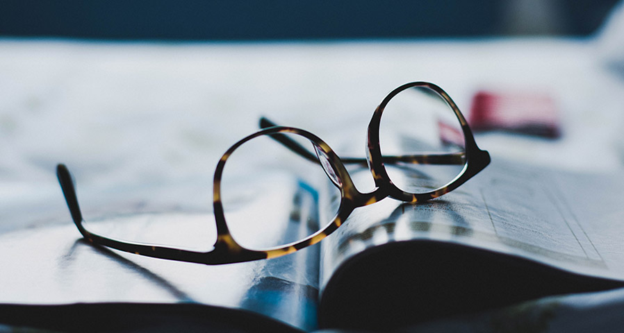 Glasses on an open book
